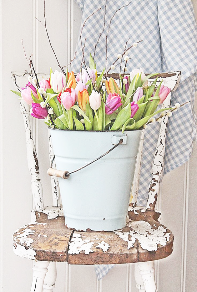 Spring flowers in a blue bucket