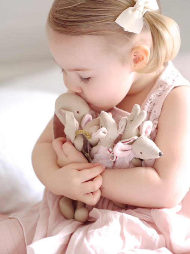 Girl kissing toys
